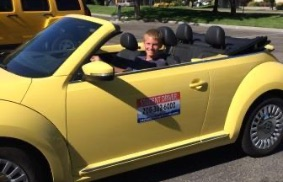 kid in yellow car
